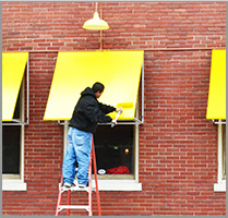 person installing window awning
